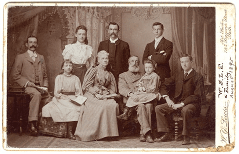 The Le Feuvre family in August 1895 (courtesy Simon Jenkins) Left to right: Charlie, Annie, Ithiel, Jane, Arthur, Samuel, Gertrude, Edmund, Vincent. Photographer: W.G. Lewis, 1 and 2, Seymour Street, Bath