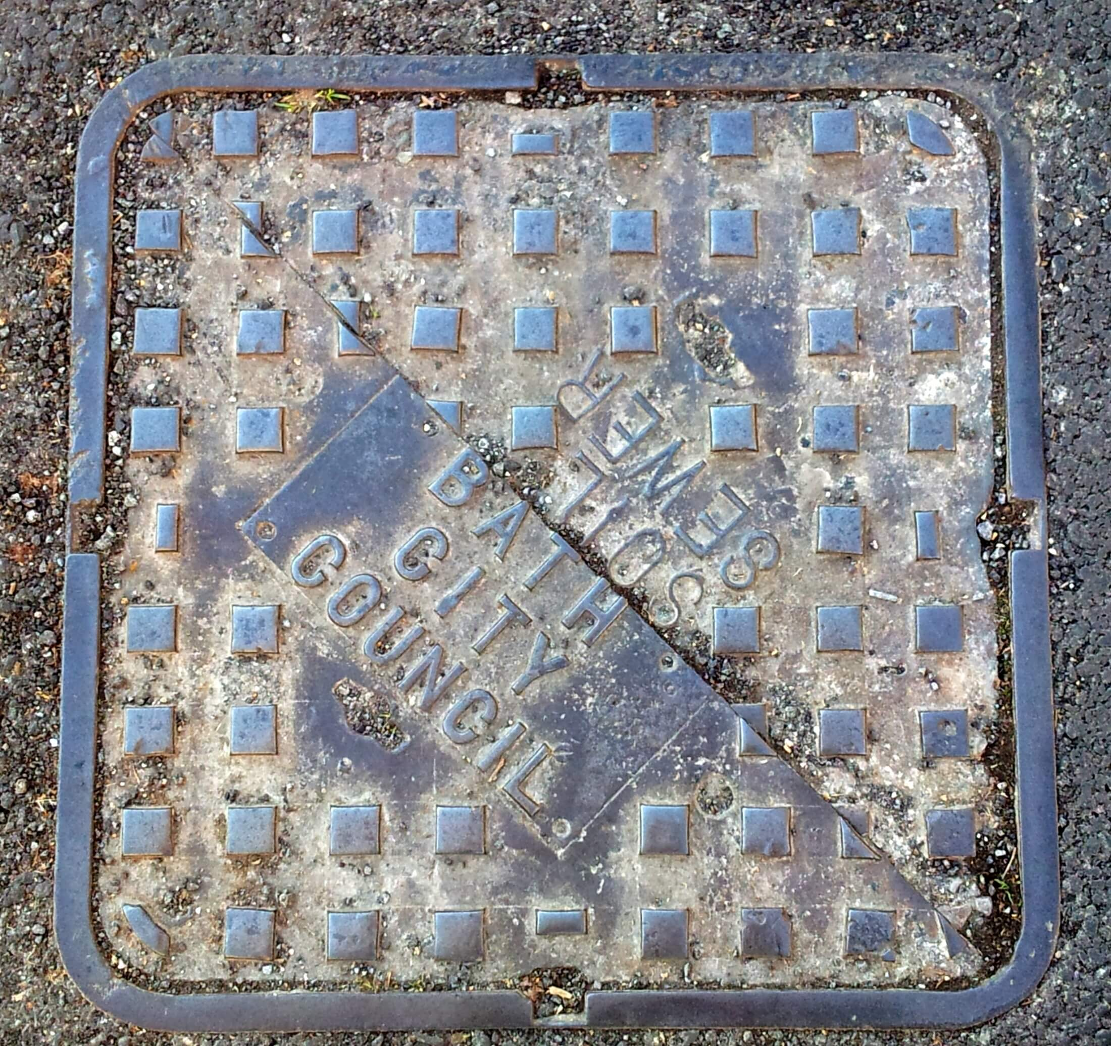 Bath City Council sewerage plates on Church Road by Belmont