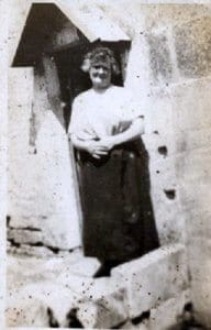 My Grandmother standing in the doorway of Her home in Quarry Vale