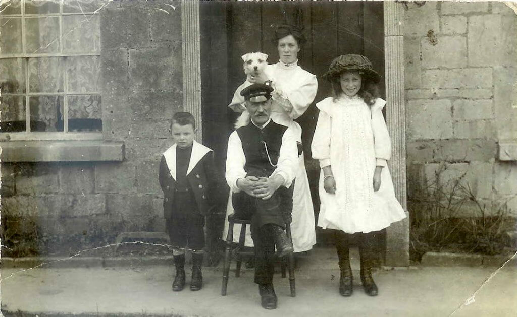 White family in front of 3a Greendown Cottage in Combe Down. Albert White, his second wife Florence, their son Frank. Also Gladys White, from Albert's first marriage to Mary Stennard