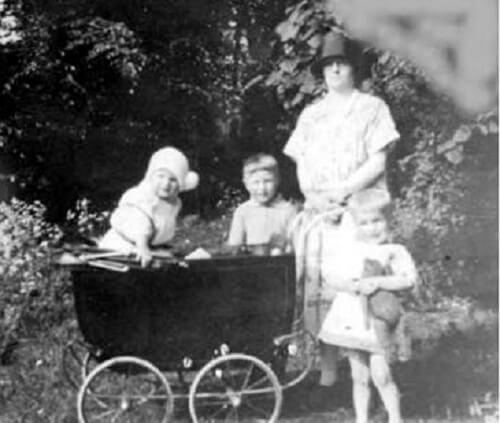 Frank Sumsion (b 1926) at the Priory 1927, his mother with brother Ted at rear