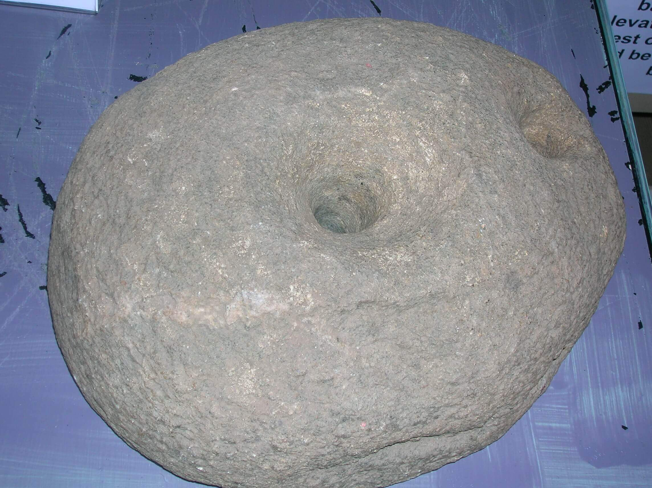 An upper quern stone from Dalgarven Mill. The Ayrshire Museum of Country Life & Costume. North Ayrshire, Scotland
