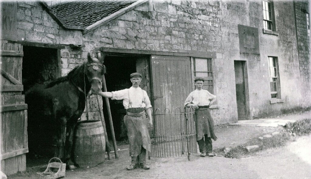 Smithy opposite the Cross Keys 1930s with horse and people